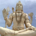Lord Shiva in meditation pose greets devotees outside the temple
